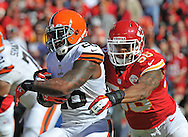 KANSAS CITY, MO - OCTOBER 27:  Linebacker Derrick Johnson #56 of the Kansas City Chiefs tackles running back Willis McGahee #26 of the Cleveland Browns for a loss during the first half on October 27, 2013 at Arrowhead Stadium in Kansas City, Missouri.  (Photo by Peter Aiken/Getty Images) *** Local Caption *** Derrick Johnson;willis McGahee