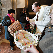 VENICE, ITALY - JANUARY 15:  Don Filippo Chiafoni Chaplain of the Church of S Francesco blesses a cat  during a special service held on January 15, 2012 in Venice, Italy. The blessing of animals and pets is a very ancient tradition dating back from San Francis of Assisi.