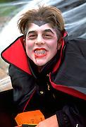 Boy age 16 in Dracula costume at Anoka Halloween Festival.  Anoka Minnesota USA