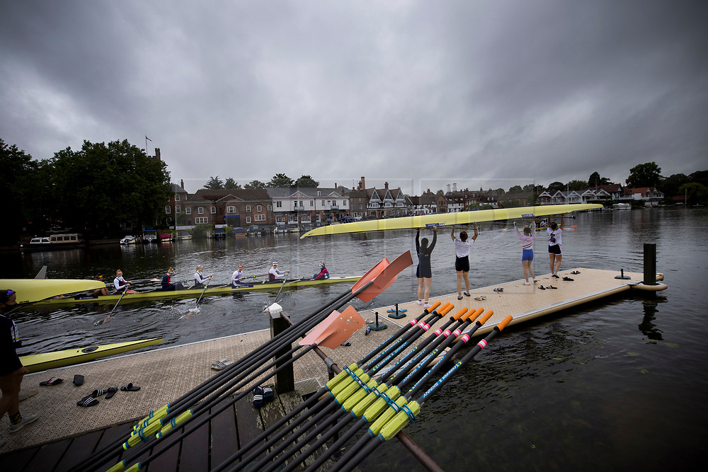 © Licensed to London News Pictures. 09/08/2021. Henley-on-Thames, UK. Rowers train underneath grey skies, ahead of the the Henley Royal Regatta which starts on Wednesday, set on the River Thames by the town of Henley-on-Thames in Oxfordshire, England. Established in 1839, the five day international rowing event, raced over a course of 2,112 meters (1 mile 550 yards), is considered an important part of the English social season. Photo credit: Ben Cawthra/LNP