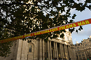 An anti-capitalist message declaring capitalism means war on stretched tape below the pillars and columns of the Sir Christopher Wren-designed St Paul's Cathedral on the 11th day of the Occupy London protest camp in its churchyard, London 26/11/11. Forced to close for the first time since the 2nd world war, due to health and safety concerns, preventing services City lawyers are using medieval pedestrian bylaws to gain a court injunction to evict the activists who set up tents and shelters.