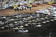 ZHENGZHOU, CHINA - MARCH 12: (CHINA OUT)<br /> <br /> 73 Vehicles Damaged In Fire<br /> <br /> burnt out vehicles at a parking lot on March 12, 2014 in Zhengzhou, Henan Province of China. 73 cars worth up to 5 million yuan (814,000 USD) were damaged in a fire in a parking lot in Zhengzhou. The fire reportedly started at around 10 a.m. on Wednesday and was put out an hour and a half later. Most of the cars are new, including 43 Morris Garages (MG) vehicles and 30 Cadillac vehicles. <br /> ©Exclusivepix