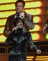 "© Licensed to London News Pictures. 20/01/2013. London, UK.   Marie Osmond of Donny and Marie Osmond performing live at The O2 Arena, on the opening night of their Donny & Marie Live tour Sunday 20 January 2013.  .Donald Clark ""Donny"" Osmond (born December 9, 1957) is an American singer, musician, actor, dancer, radio personality, and former teen idol. Donny Osmond has also been a talk and game show host, record producer and author. In the mid 1960s, he and four of his elder brothers gained fame as The Osmonds on the long running variety program, The Andy Williams Show. Donny went solo in the early 1970s covering such hits as ""Go Away Little Girl"" and ""Puppy Love""...Olive Marie Osmond (born October 13, 1959) is an American singer, actress, doll designer, and a member of the show business family The Osmonds. Although she was never part of her family's singing group, she gained success as a solo country music artist in the 1970s and 1980s. .For over thirty-five years, Donny and Marie have gained fame as Donny & Marie, partly due to the success of their 1976-79 self-titled variety series, which aired on ABC. The duo also did a 1998-2000 talk show and have been headlining in Las Vegas since 2008.   Photo credit : Richard Isaac/LNP"
