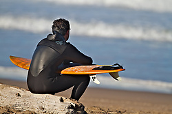 Surfer contemplating waves during a brake in the action in Morro Bay California