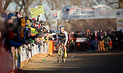 SHOT 1/12/14 4:44:25 PM - Timothy Johnson (#2) of Topsfield, Ma.  high fives fans as he makes his way towards the finish line in the Men's Elite race at the 2014 USA Cycling Cyclo-Cross National Championships at Valmont Bike Park in Boulder, Co. Johnson finished third in the race. (Photo by Marc Piscotty / © 2014)