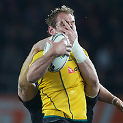 Wallabies Captain Rocky Elsom is grabbed in the face by Ali Williams after winning a line out during the New Zealand V Australia Tri-Nations, Bledisloe Cup match at Eden Park, Auckland. New Zealand. 6th August 2011. Photo Tim Clayton