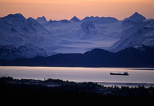 Industry, Oil tanker in Katchmak Bay at dawn. Chugach Mountain Range in background. Alaska.