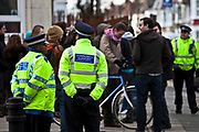 Local police and community support officers policing a peaceful demonstration Hackney, London.