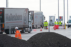 © Licensed to London News Pictures 06/01/2021.         Ashford, UK. Freight lorries on the site while testing takes place and workmen work. The Sevington Inland Border Facility in Ashford, Kent has opened its gates to freight traffic heading to Europe. Lorry drivers are receiving Covid-19 tests on part of the site while workmen continue to complete the 66 acre plot which will hold 1700 trucks when finished. Photo credit:Grant Falvey/LNP