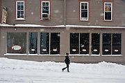Feb 10,2010 - Herndon, Va USA - A woman carries two cups of coffee as she makes her way through the blizzard conditions in historic Herndon, Virginia on Wednesday.(Credit Image: ©Pete Marovich/ZUMA Press)