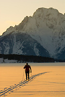 A young woman nordic skis on Jackson Lake in Grand Teton National Park in Jackson Hole, Wyoming.