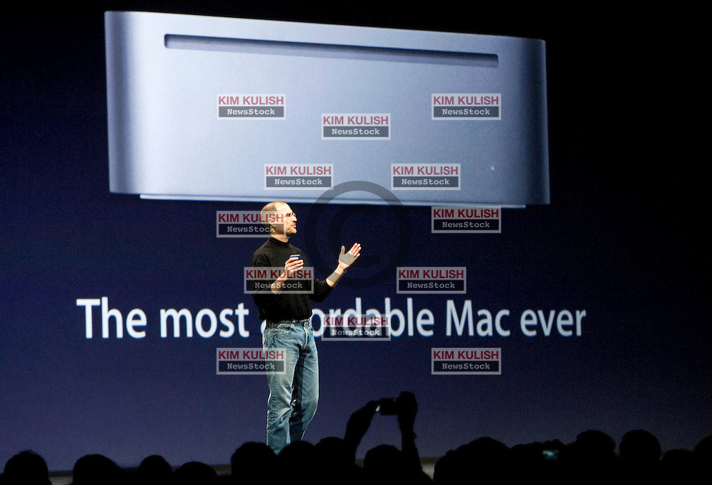 Apple CEO Steve Jobs  announces the new Mac Mini computer' at the 2005 Macworld Expo January 11, 2005 in San Francisco, California. Jobs announced several new products including the new Mac Mini personal computer starting at $499 and the iPod shuffle MP3 player for $99  Photo ©2005  by Kim Kulish