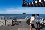 youth at Umikaze park, Yokosuka with Tokyo Bay and Sarushima Island