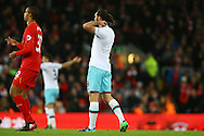 Andy Carroll of West Ham United plays on with no number on his shirt. Premier League match, Liverpool v West Ham Utd at the Anfield stadium in Liverpool, Merseyside on Sunday 11th December 2016.<br /> pic by Chris Stading, Andrew Orchard sports photography.