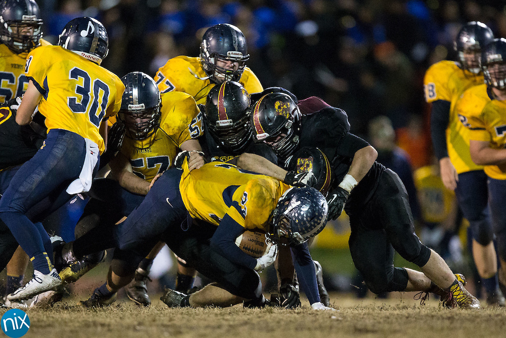 Tyree Hallman (22) of the South Iredell Vikings is brought down by several JM Robinson Bulldogs defenders during second half action at South Iredell High School November 20, 2015, in Statesville, North Carolina.  The Vikings defeated the Bulldogs 14-13.  (Brian Westerholt/Special to the Tribune)