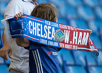 Football - 2016/2017 Premier League - Chelsea V West Ham United. <br /> <br /> In the news this week Chelsea said they were trying to ban the half and half scarfs.  A young fan proudly shows his support ahead of the game with a hafl and half scarf at Stamford Bridge.<br /> <br /> COLORSPORT/DANIEL BEARHAM