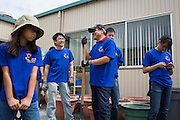 Ark Baptist Church volunteers chat with eachother during the Earth Day clean up activities at Zanker Elementary School in Milpitas, California, on April 24, 2016. (Stan Olszewski/SOSKIphoto)