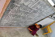 Young novice monks near the blackboard at a school in Sikkim, India