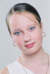 Studio portrait of teenage girl,