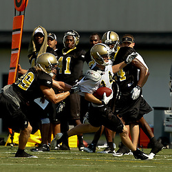 August 1, 2010; Metairie, LA, USA; New Orleans Saints wide receiver Andy Tanner (14) is grabbed by safety Chris Reis (39) during a training camp practice at the New Orleans Saints practice facility. Mandatory Credit: Derick E. Hingle