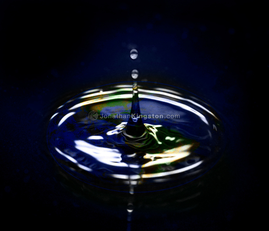 A conceptual image of the earth seen thru the concentric circles left by a drop of water.  The image illustrates the fragile state of our natural world and the many challenges science and government face in curbing global warming.