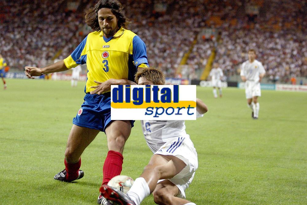 FOOTBALL - CONFEDERATIONS CUP 2003 - GROUP A - JAPAN v COLOMBIA  - 030622 - JUNICHI INAMOTO (JAP) / MARIO YEPES (COL)  - PHOTO JEAN MARIE HERVIO / DIGITALSPORT