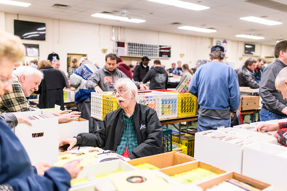 Arbutus, Maryland - February 18, 2018: Jim Kuppers, from Ashburn, Va. sells records and collectables at his table during the monthly Arbutus Record Show at the Arbutus Volunteer Fire Department Hall in Arbutus, Maryland, Sunday, Feb. 18, 2018.<br /> <br /> <br /> CREDIT: Matt Roth