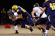Milpitas High School defensive lineman Jason Scrempos (88) makes a tackle against Woodside at Milpitas High School in Milpitas, California, on September 13, 2013. The Trojans went on to beat the Wildcats 50-6. (Stan Olszewski/SOSKIphoto)