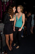 Rose Hanbury and Sophia  Hesketh. party given by Daphne Guinness for Christian Louboutin  after the opening of his new shopt.  Baglione Hotel. 16 March 2004.  ONE TIME USE ONLY - DO NOT ARCHIVE  © Copyright Photograph by Dafydd Jones 66 Stockwell Park Rd. London SW9 0DA Tel 020 7733 0108 www.dafjones.com