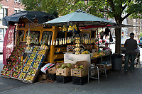 This fruit seller on 171st street and St. Nicholas Avenue uses an old school bus for transportation and as the center of his business. You gotta love the creativity.