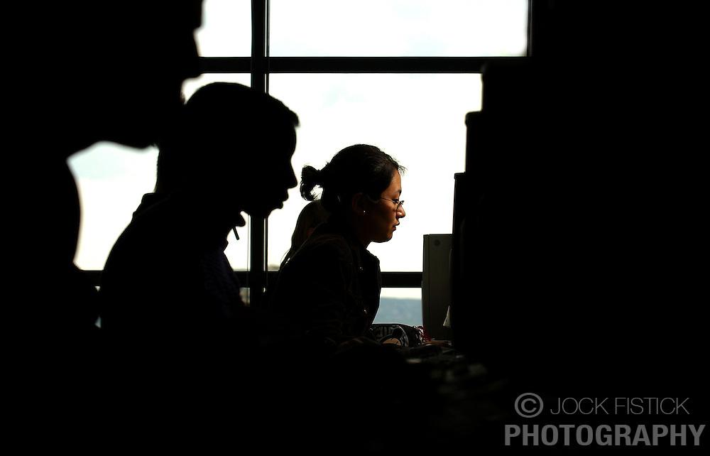 PARIS -  FRANCE - APRIL-21-2004 - Men and women work with computers.