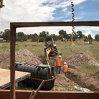 082614      Cayla Nimmo<br /> <br /> A crew from the Navajo Engineering Construction Authority (NECA) began to install a water tank and drainage system in the Bech family yard near Navajo, New Mexico on Tuesday.