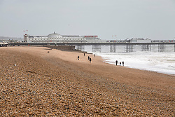 © Licensed to London News Pictures. 27/04/2019. Brighton, A near empty beach as strong winds and the occasional cloudy weather is hitting the seaside resort. Storm Hannah has been hitting Brighton and Hove throughout Friday night. Brighton and Hove. Photo credit: Hugo Michiels/LNP