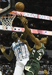 October 17, 2018 - Charlotte, NC, USA - The Milwaukee Bucks' Giannis Antetokounmpo (34) drives to the hoop against the Charlotte Hornets' Marvin Williams (2) during the first half at the Spectrum Center in Charlotte, N.C., on Wednesday, Oct. 17, 2018. (Credit Image: © David T. Foster Iii/Charlotte Observer/TNS via ZUMA Wire)