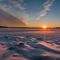 The sun's last rays fall over a sea of snow and ice near Lloyd Harbor on Long Island's north shore.