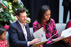 December 12, 2016 - Washington, DC, United States - On Monday, December 12, patients, families, and staff of Children's National Health System, were visited in the Main Atrium by, (l-r), 5-year-old patient Abi Soliman, Ryan Seacrest, and First Lady Michelle Obama.....Mr. Seacrest, and Mrs. Obama, read the holiday classic 'Twas the Night before Christmas to the audience. (Credit Image: © Cheriss May/NurPhoto via ZUMA Press)