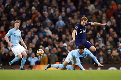 Tottenham Hotspur's Harry Kane (right) and Manchester City's Kyle Walker battle for the ball during the Premier League match at the Etihad Stadium, Manchester.