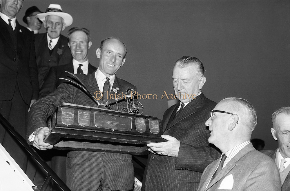 Charlie Keegan, from Wicklow returns home from Austria with the Golden Plough trophy as World Champion Ploughman  which he won against a field of 39 competitors. .04.10.1964