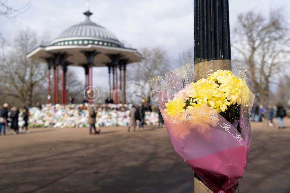 Bouquets of flowers are left at the bandstand on Clapham Common for murdered woman Sarah Everard on 15th March 2021, in London, United Kingdom. The Clapham Common bandstand was the scene on Saturday for a night-time vigil by London women but was broken up because of government Covid restrictions.