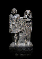 Ancient Egyptian bust of a man and women, serpentine, Middle Kingdom, late 12th-13th Dynasty (1800-1700 BC). Egyptian Museum, Turin. black background<br /> <br /> An example of Egyptian private statues, probably low ranking officials, inv 1222 &1233 .<br /> <br /> If you prefer to buy from our ALAMY PHOTO LIBRARY  Collection visit : https://www.alamy.com/portfolio/paul-williams-funkystock/ancient-egyptian-art-artefacts.html  . Type -   Turin   - into the LOWER SEARCH WITHIN GALLERY box. Refine search by adding background colour, subject etc<br /> <br /> Visit our ANCIENT WORLD PHOTO COLLECTIONS for more photos to download or buy as wall art prints https://funkystock.photoshelter.com/gallery-collection/Ancient-World-Art-Antiquities-Historic-Sites-Pictures-Images-of/C00006u26yqSkDOM