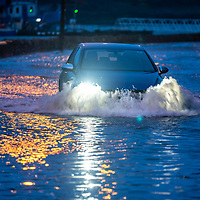 A car drives through water in Kinsale at high tide as the Bandon river flooded parts of the town.<br /> Picture. John Allen