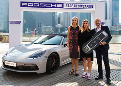October 20, 2018 - Kallang, SINGAPORE - Simona Halep of Romania receives the Porsche 718 Boxster GTS prize car for the Porsche Race to Singapore ahead of the 2018 WTA Finals tennis tournament (Credit Image: © AFP7 via ZUMA Wire)