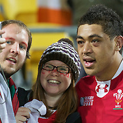 Toby Faletau, Wales, has his photograph taken with fans after the Ireland V Wales Quarter Final match at the IRB Rugby World Cup tournament. Wellington Regional Stadium, Wellington, New Zealand, 8th October 2011. Photo Tim Clayton...