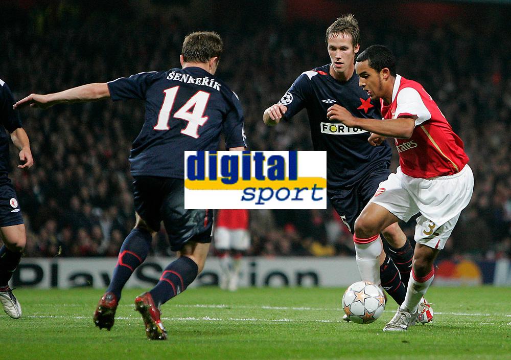 Photo: Tom Dulat.<br /> Arsenal v Slavia Prague. Group H, UEFA Champions League. 23/10/2007.<br /> Zdenek Senkerik(L) and Michal Svec(R) of Slavia Prague strugling to stop  Theo Walcott of Arsenal.