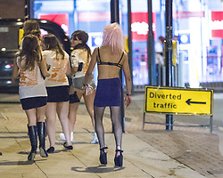 """© Licensed to London News Pictures . 22/10/2012 . Manchester , UK . A male student in a bra, skirt, stockings and heels . Students attend a Carnage UK pub crawl at bars in Manchester 's Deansgate Locks with a fancy dress theme of """" Pimps and Hoes """" . The event has been criticised for encouraging binge drinking , sexism and anti-social behaviour . Photo credit : Joel Goodman/LNP"""
