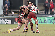 Lewis Evans (C) of the Newport Gwent Dragons is stopped in his tracks by Anton Bresler(R) and Ben Toolis (L) of Edinburgh Rugby. Guinness Pro12 rugby match, Newport Gwent Dragons v Edinburgh Rugby at Rodney Parade in Newport, South Wales on Sunday 27th March 2016.<br /> pic by  Simon Latham, Andrew Orchard sports photography.