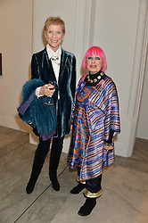 Left to right, PAULINE STONE and ZANDRA RHODES at a private view of photographs by David Bailey entitled 'Bailey's Stardust' at the National Portrait Gallery, St.Martin's Place, London on 3rd February 2014.