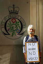 © Licensed to London News Pictures. 17/09/2019. London, UK. A protester with tape over her mouth demonstrate outside UK Supreme Court in London as the court begins a three day appeal hearing in the multiple legal challenges against the Prime Minister Boris Johnson's decision to prorogue Parliament ahead of a Queen's speech on 14 October. Eleven instead of the usual nine Supreme Court justices will hear the politically charged claim that Boris Johnson acted unlawfully in advising the Queen to suspend parliament for five weeks in order to stifle debate over the Brexit crisis. It is the first time the Supreme Court has been summoned for an emergency hearing outside legal term time. Lady Hale, the first female president of the court who retires next January, will preside. Photo credit: Dinendra Haria/LNP