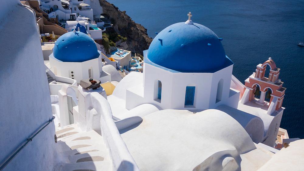 Blue dome of the Ekklisia (church) Analipsi on the Oia cliff, Santorini