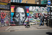 Virus face mask street art and graffiti on Brick Lane in Shoreditch as lockdown continues and people observe the stay at home message in the capital on 12th May 2020 in London, England, United Kingdom. Coronavirus or Covid-19 is a new respiratory illness that has not previously been seen in humans. While much or Europe has been placed into lockdown, the UK government has now announced a slight relaxation of the stringent rules as part of their long term strategy, and in particular social distancing.